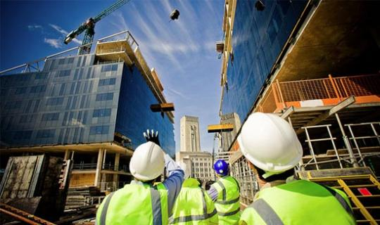 Attached Image: workers-watching-skyscraper-under-construction.jpg